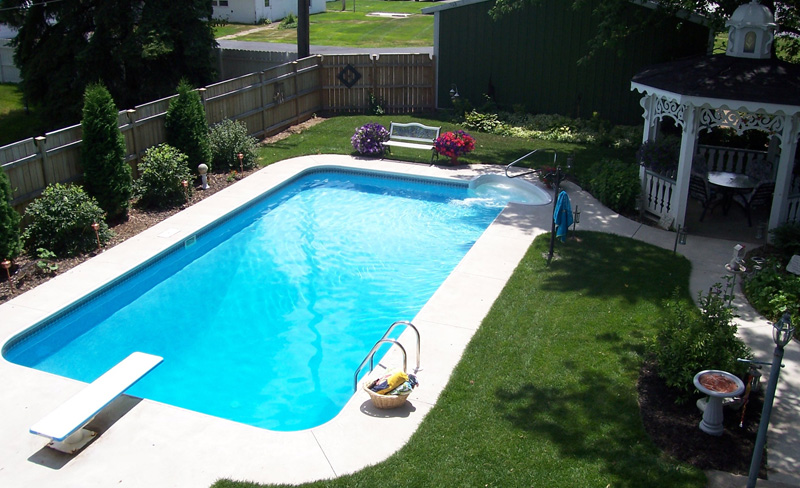 Rectangular Inground Pool Designs rectangle pool with step-down to curved concrete hardscape