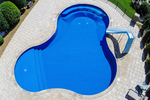 Custom Lagoon Inground Pool with Built In Bench, Step, and Sundeck